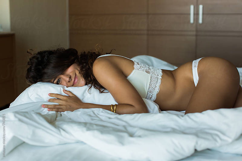 Attractive Woman Lying in Bed by Mosuno for Stocksy United