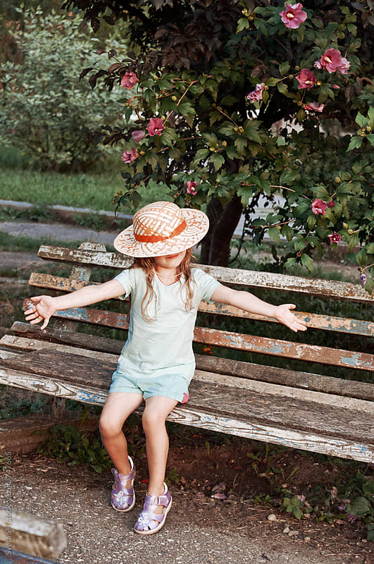 Little girl in a hat by Svetlana Shchemeleva for Stocksy United