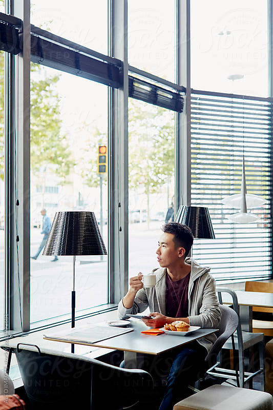 Man Having Coffee In Restaurant by ALTO IMAGES for Stocksy United