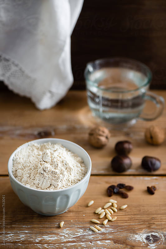 a cup of chestnut flour on a table  by Laura Adani for Stocksy United