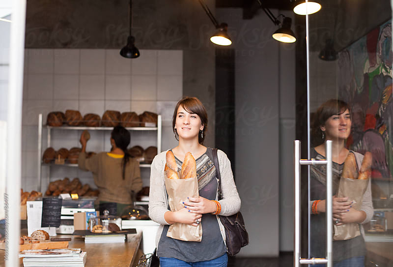 Woman Buying Bread in a Bakery by Mosuno for Stocksy United