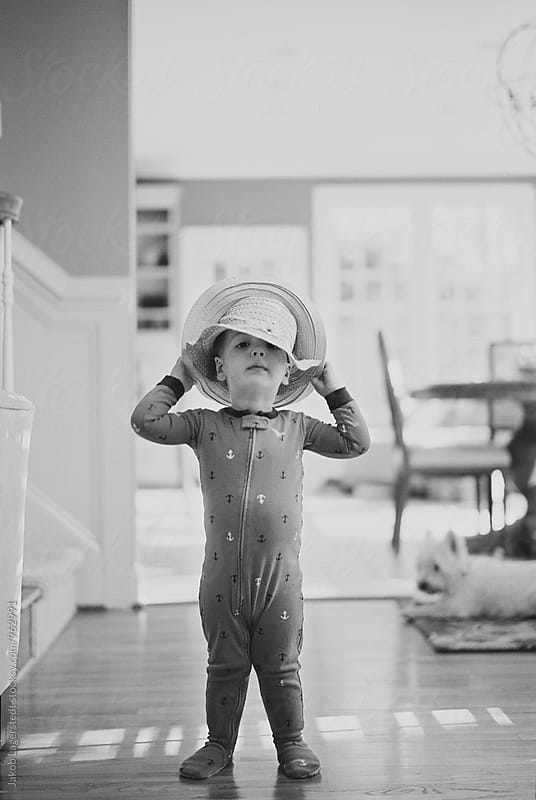 Cute boy toddler wearing two hats by Jakob for Stocksy United