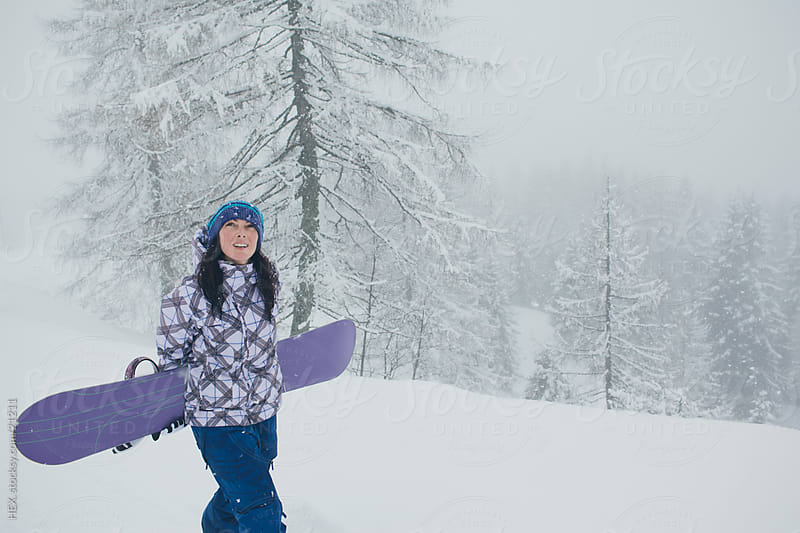 Female Snowboarder  by HEX . for Stocksy United
