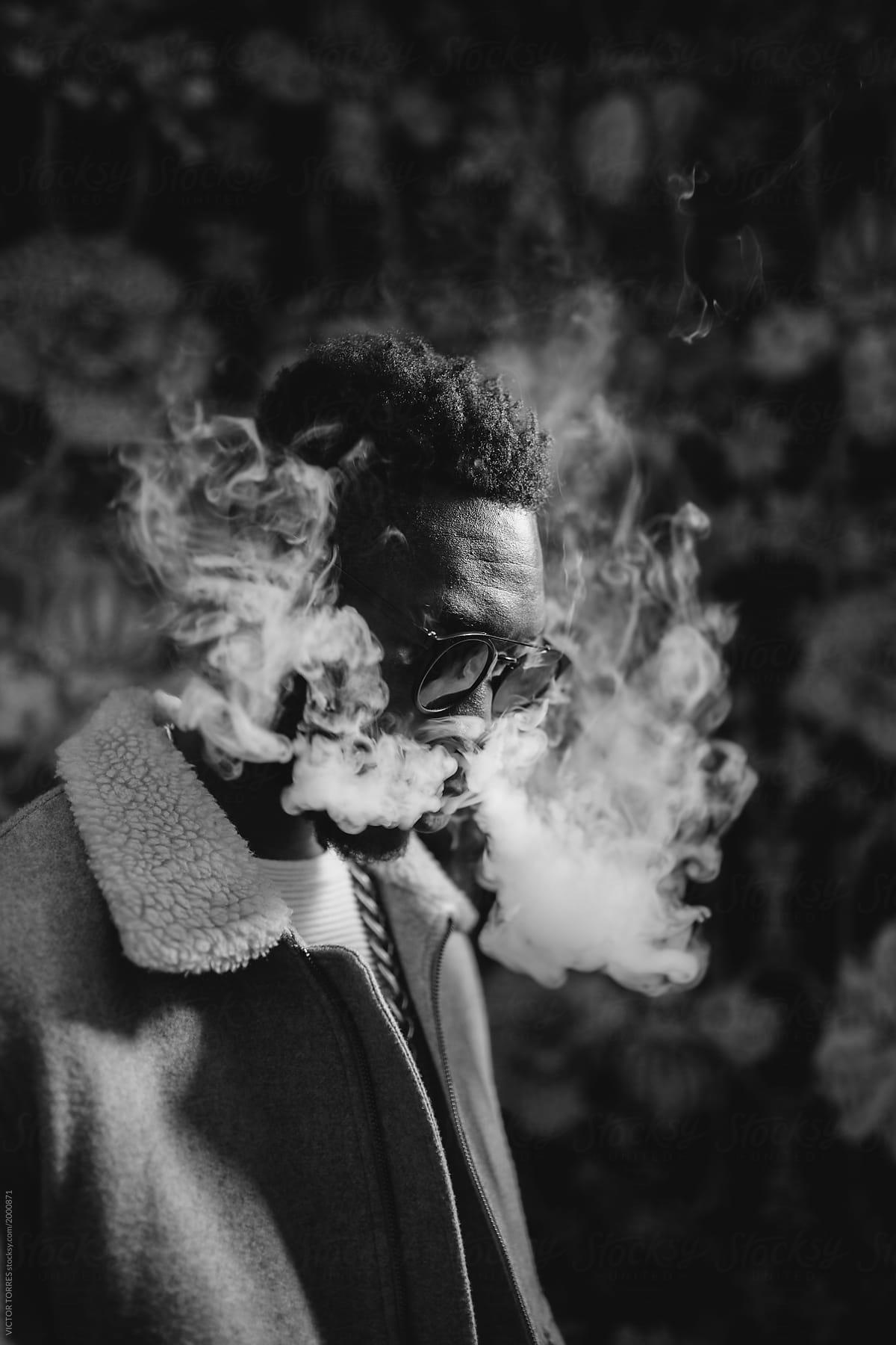Stock photo black man smoking