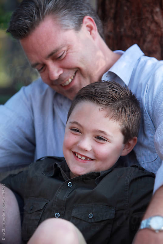 Father and son laughing together by Dina Giangregorio for Stocksy United