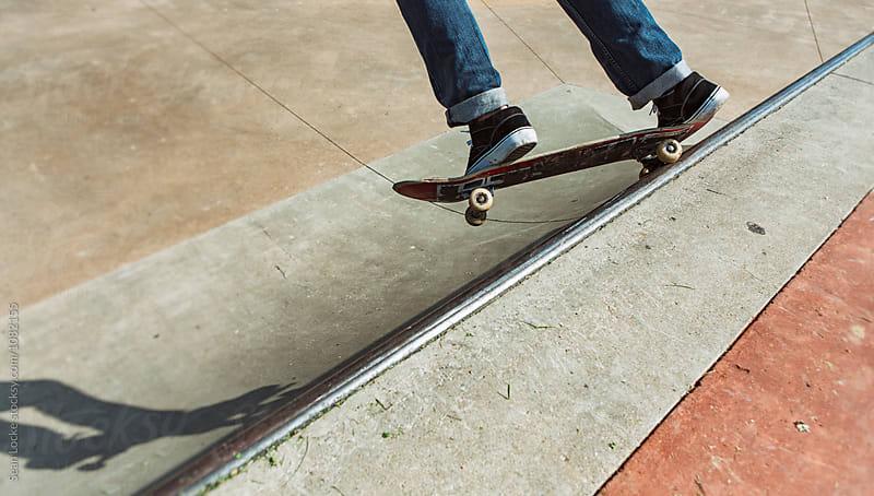 Skateboarder Balancing On Board After Hitting Bar by Sean Locke for Stocksy United