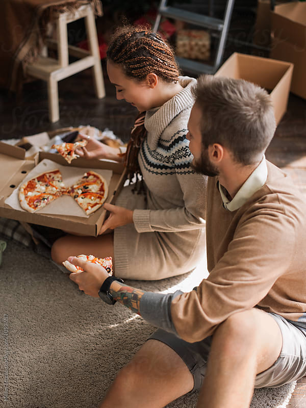 Couple eating pizza by Milles Studio for Stocksy United