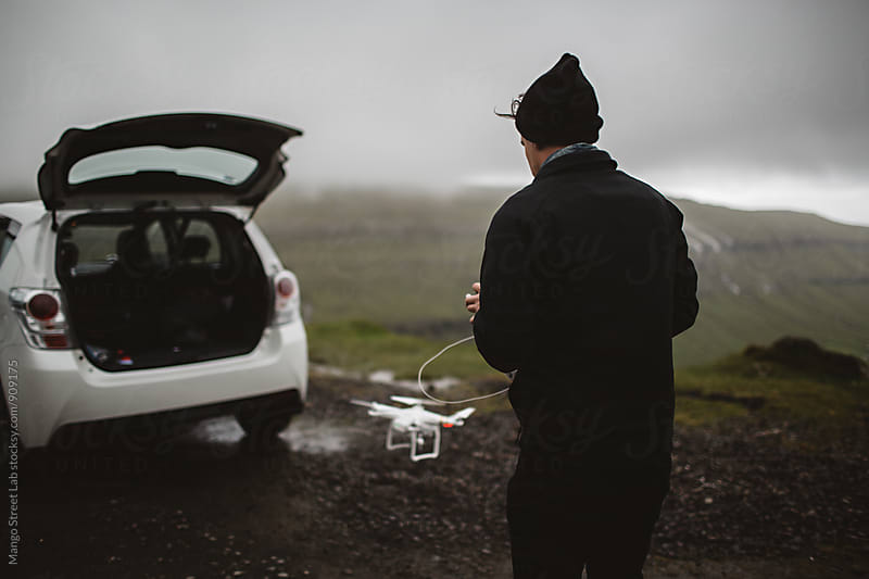 A Boy Flying A Drone in the Faroe Islands by Rachel Gulotta Photography for Stocksy United