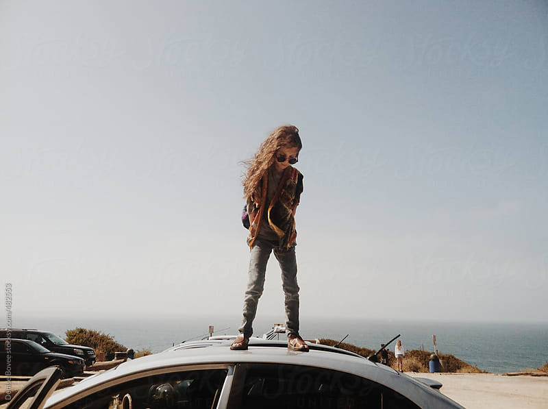 Child Standing on Car by Denise Bovee for Stocksy United