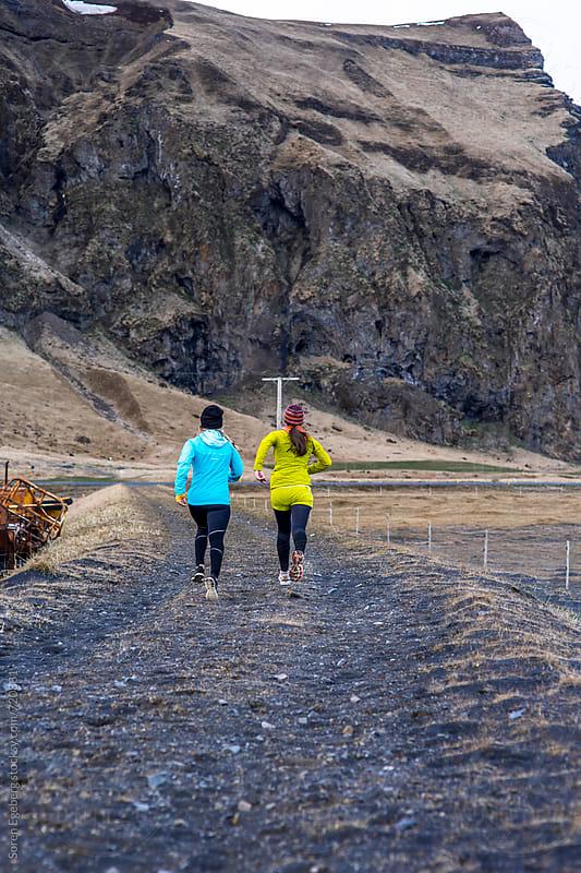 Two girls running outdoors by Soren Egeberg for Stocksy United