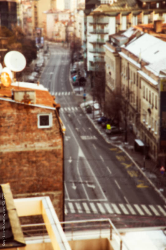 empty city street from above in blur by Sonja Lekovic for Stocksy United