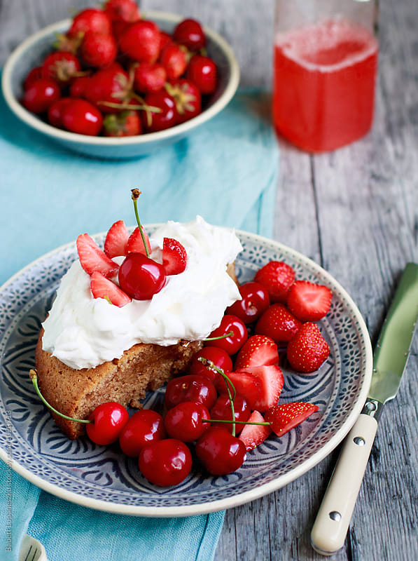 Slice cake with whipped cream, fresh fruit by Babett Lupaneszku for Stocksy United