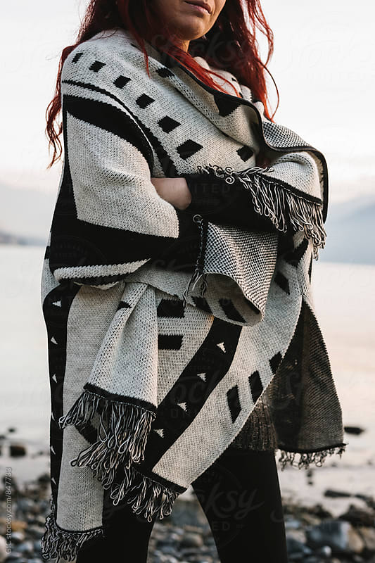 Woman wearing a poncho during a winter day by WAVE for Stocksy United