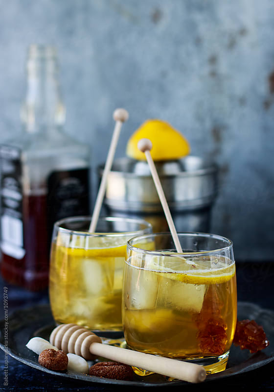 Bourbon  coctails with lemon and honey by Viktorné Lupaneszku for Stocksy United