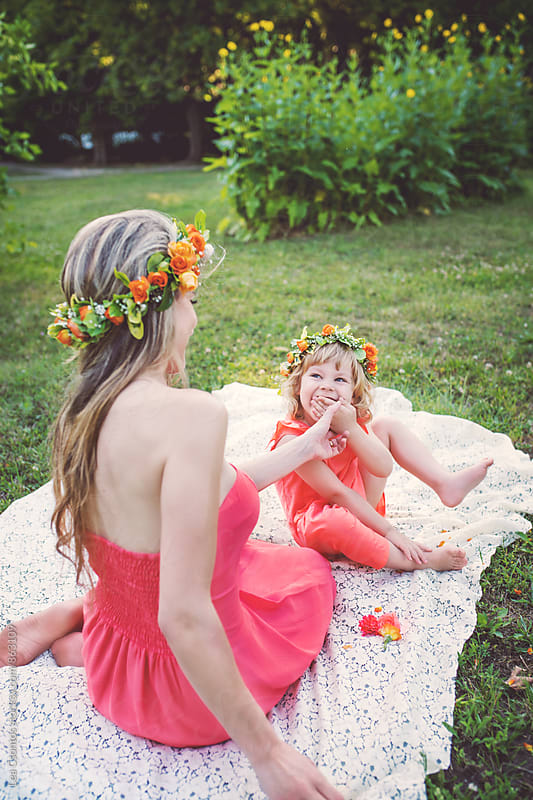 Mother and daughter having fun outdoors by Lea Csontos for Stocksy United