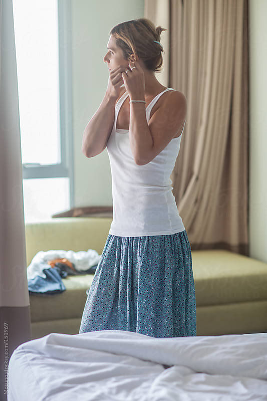 Woman Standing in a Hotel Room by Mosuno for Stocksy United