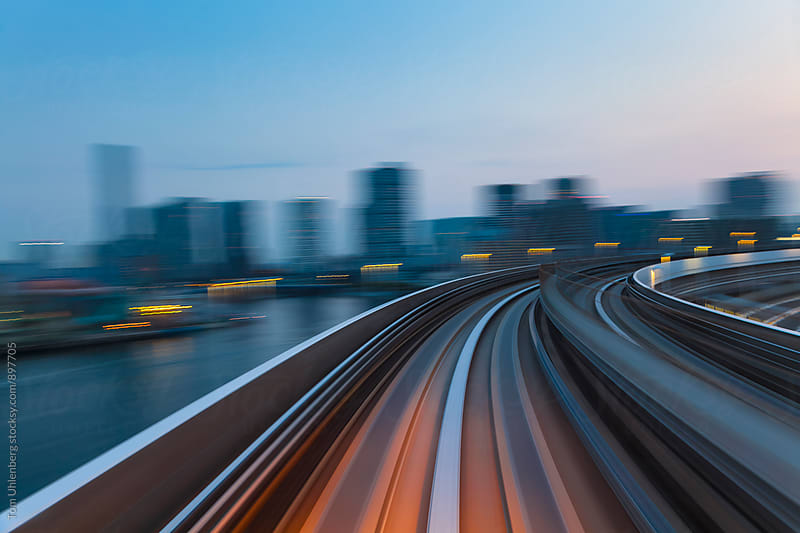 Speed and Motion - Evening Ride on a Train through a City by Tom Uhlenberg for Stocksy United