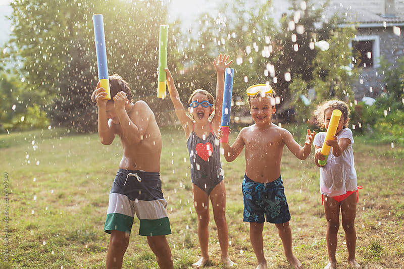 Children playing with water in hot summer days by Dejan Ristovski for Stocksy United