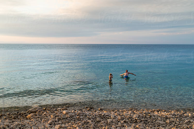 Father and Son Swimming In Cold Freshwater Lake Camping on Georgian Bay by JP Danko for Stocksy United