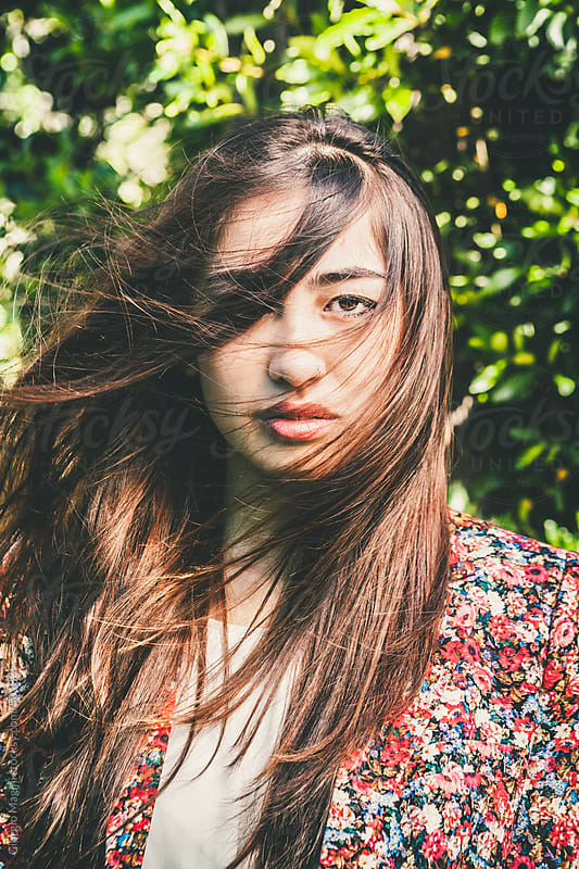 Windy Portrait of an Asian Girl with Long Hair by Giorgio Magini for Stocksy United
