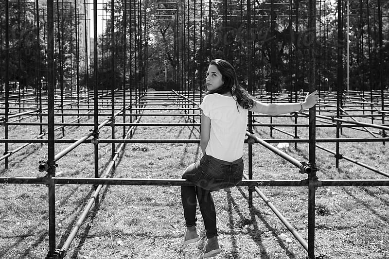 Young woman near a metal construction by Maja Topcagic for Stocksy United