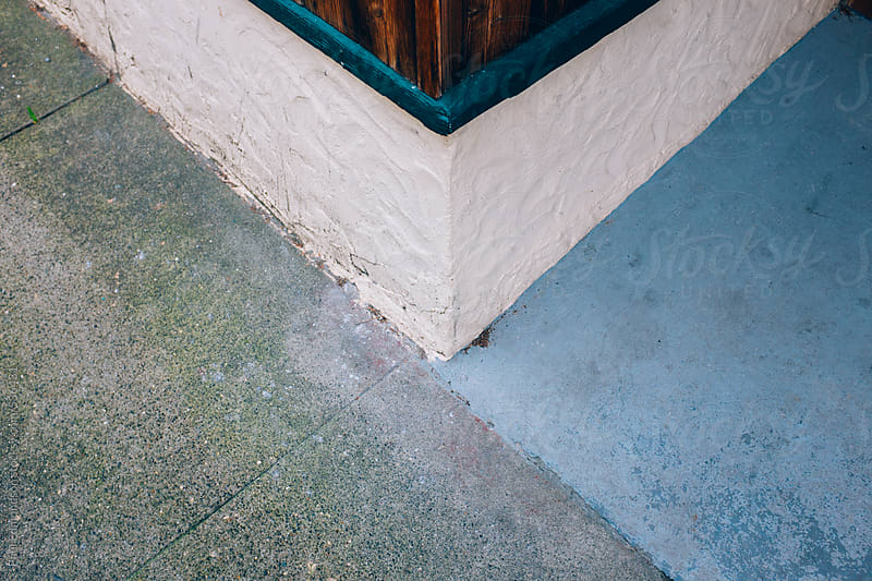 Exterior wall corner and sidewalk. close up by Paul Edmondson for Stocksy United