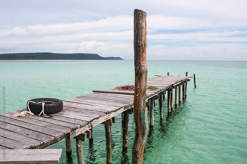 Wooden dock on turquoise water sea on tropical exotic island by Alejandro Moreno de Carlos for Stocksy United