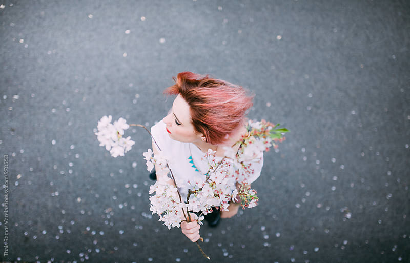 pink haired woman moving her hair by Thais Ramos Varela for Stocksy United