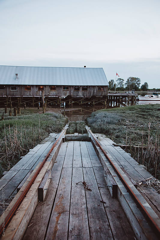 Old shipyard and bridge at dusk by Carey Shaw for Stocksy United