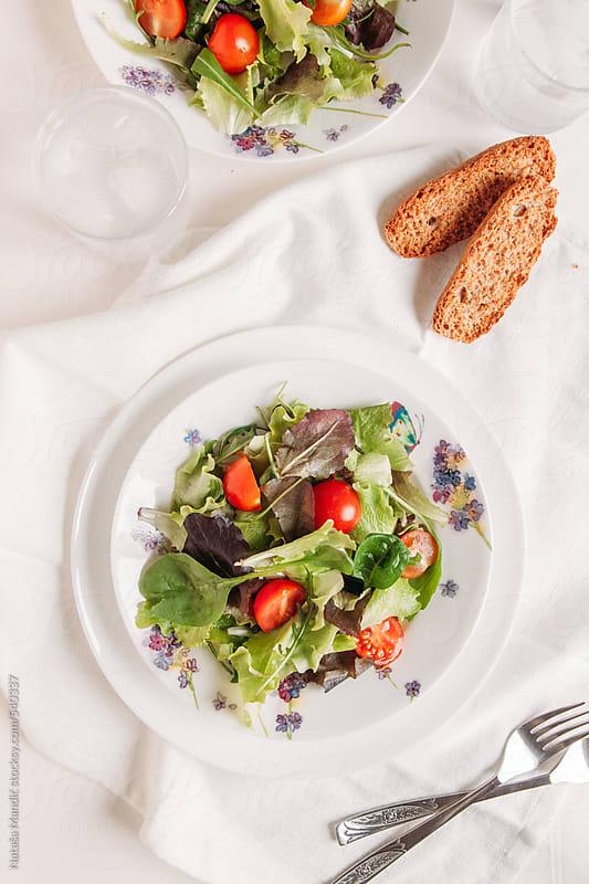 Fresh salad with cherry tomatoes  by Nataša Mandić for Stocksy United