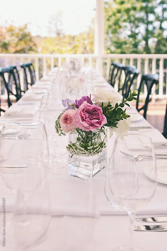 long table at a wedding by Gillian Vann for Stocksy United