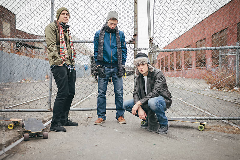 Winter Portrait of Young Men with Industrial Background in Brooklyn by Joselito Briones for Stocksy United