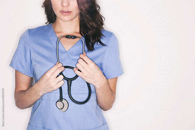 Medical: Female Doctor Holding Stethoscope by Sean Locke for Stocksy United