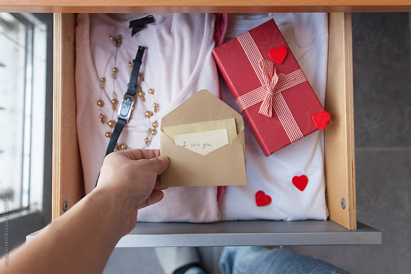 Woman Looking at Valentine's Surprise in Her Drawer by Mosuno for Stocksy United