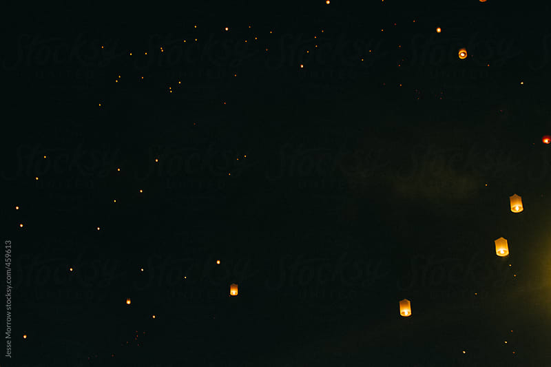 Lanterns floating above chiang mai in thailand by Jesse Morrow for Stocksy United