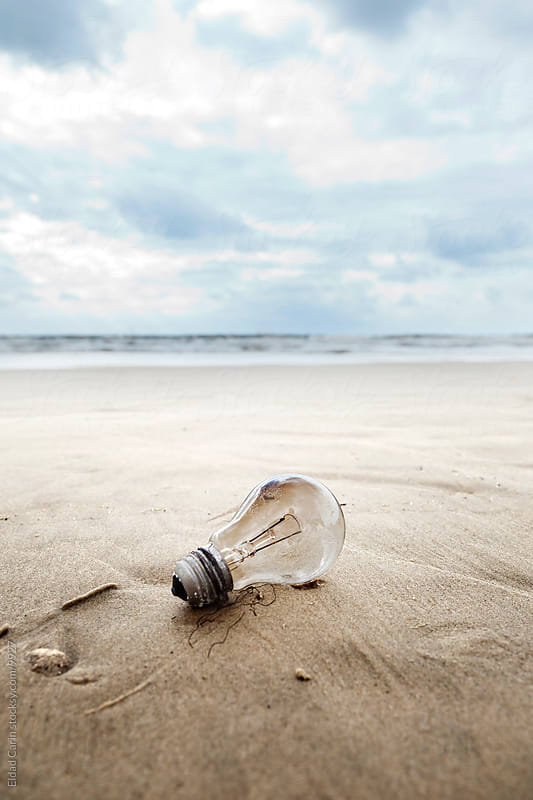 Burnt Light Bulb on Winter Beach - Environment by Eldad Carin for Stocksy United