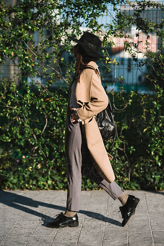 Stylish young woman walking in the city by GIC for Stocksy United