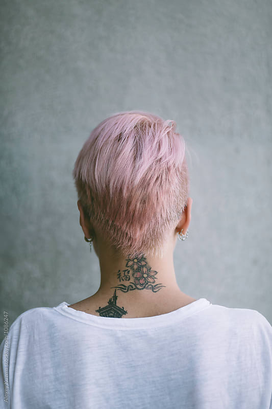 woman with pink hair by Alexey Kuzma for Stocksy United