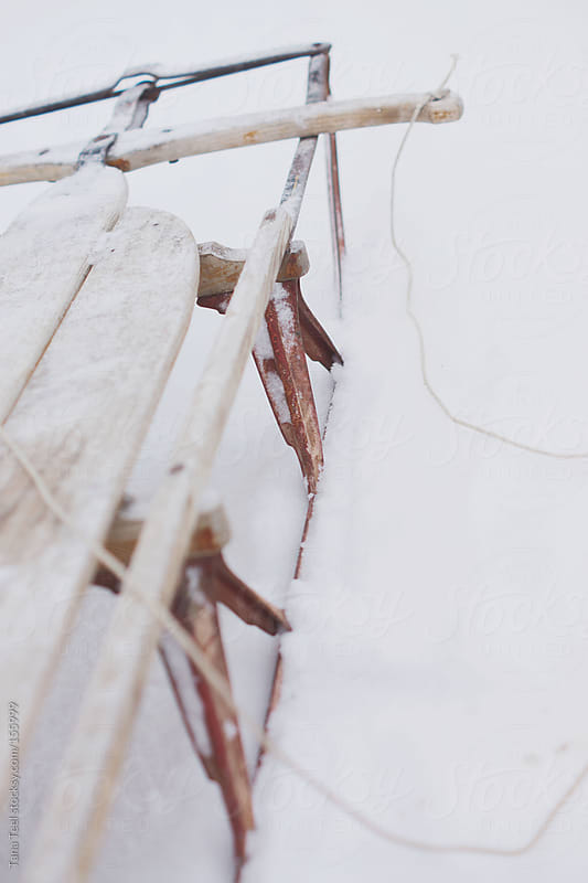 Wooden sled in the snow by Tana Teel for Stocksy United