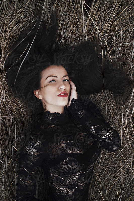 Girl laying in field by Jovana Rikalo for Stocksy United
