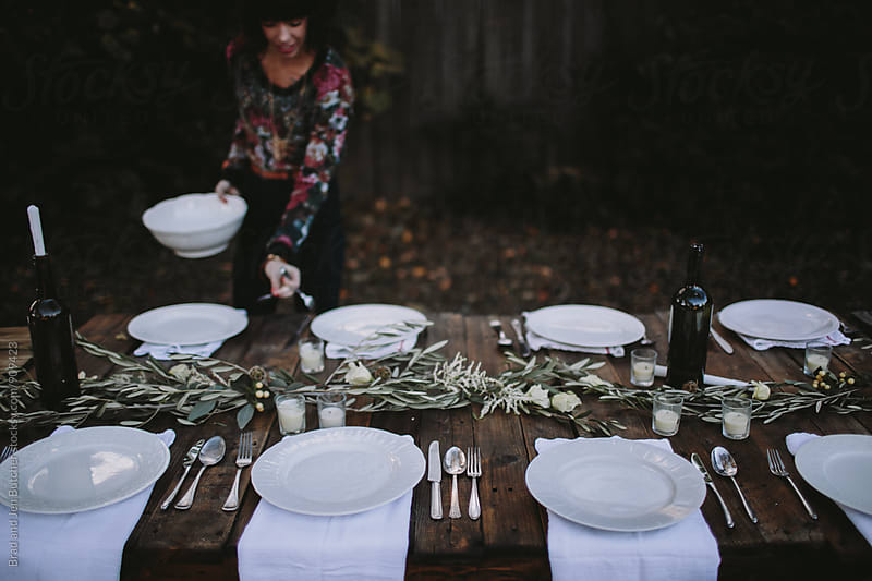Woman Setting Table by Brad and Jen Butcher for Stocksy United