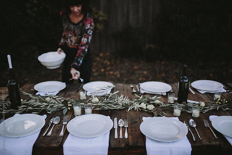 Woman Setting Table by Brad & Jen for Stocksy United