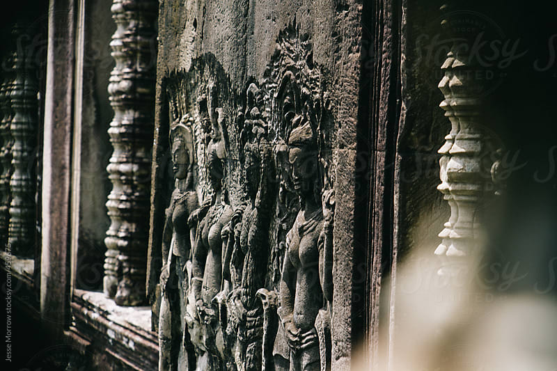 Ancient Buddhist figures in temple by Jesse Morrow for Stocksy United