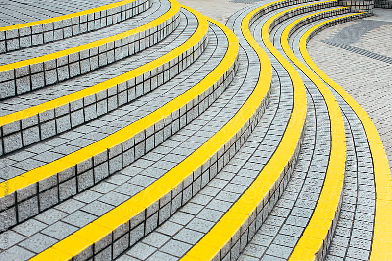 Curved Stairway with Yellow Demarcation Lines by VISUALSPECTRUM for Stocksy United