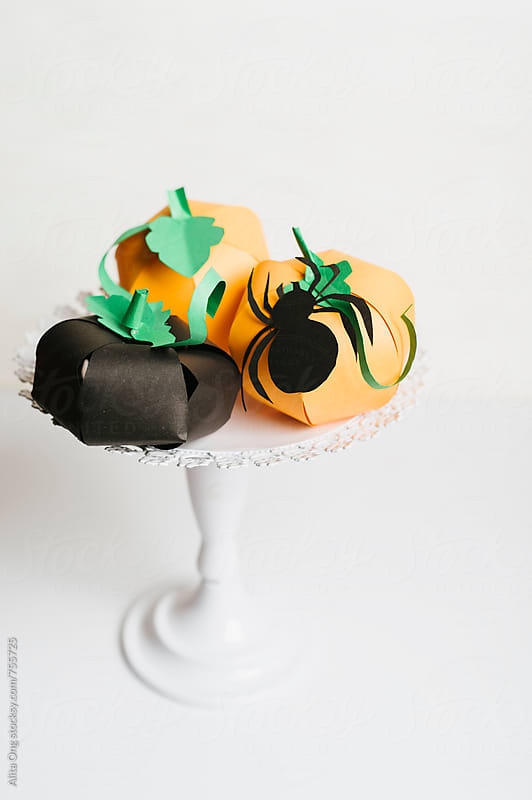 Paper Halloween pumpkins by Alita Ong for Stocksy United