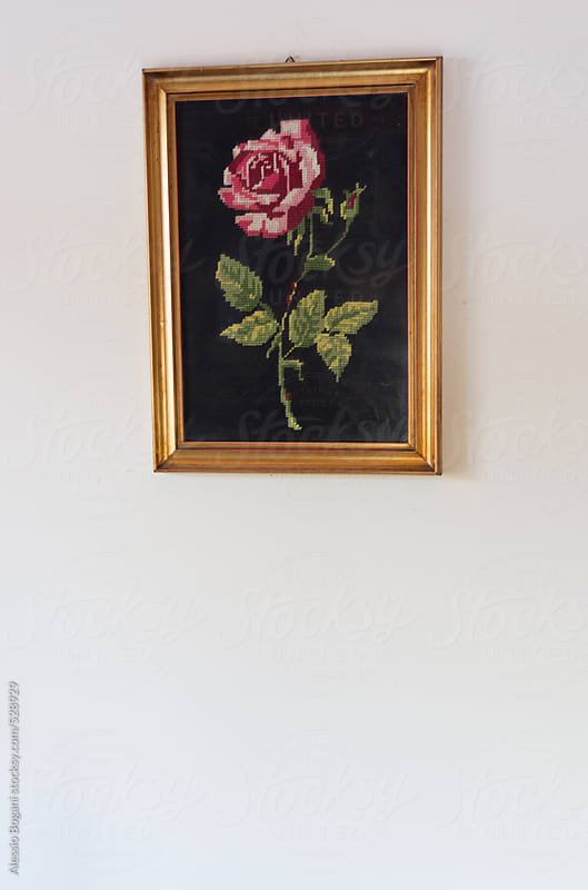 Embroidery framed rose flower with copyspace by Alessio Bogani for Stocksy United