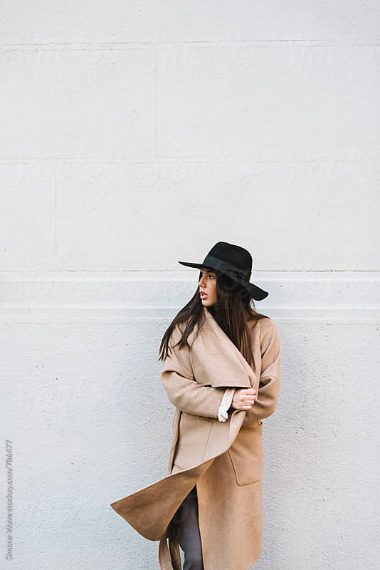 Stylish woman with autumn coat by WAVE for Stocksy United