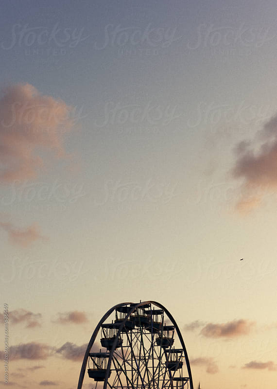 ferris wheel at sunset by otto schulze for Stocksy United