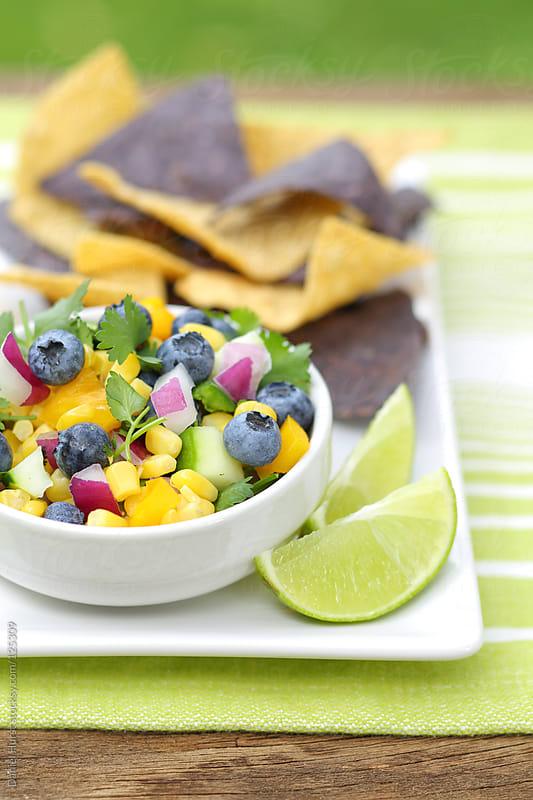 Blueberry corn salsa by Daniel Hurst for Stocksy United