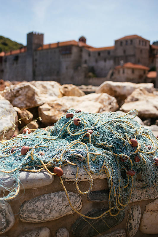 Fishing nets and ropes by Marko Milovanović for Stocksy United